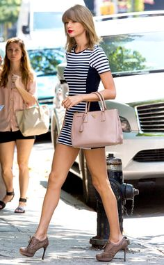 Earn Your Stripes from Celebrity Street Style Have stripes ever looked so good? Taylor Swift nails it in a monochromatic striped mini paired with a lush Prada bag.
