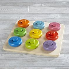 Shop Roundabout Wooden Baby Puzzle.  Our Roundabout Wooden Baby Puzzle is the perfect game for little hands.  This 18-piece set is made from sturdy beechwood and features brightly colored rings and matching cylinders.