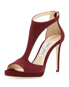 "Jimmy Choo suede sandal. 4"" covered heel; 0.75"" platform; 3.25"" equiv. Open toe. T-strap vamp. Back zip eases dress. Padded footbed. Leather sole and lining. Smooth outsole. ""Lana"" is made in Italy."