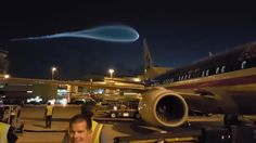 The incredible footage, believed to have been filmed at Miami Airport, led to those on the tarmac whipping out their camera phones to snap the strange phenomenon.  Read more: http://www.dailymail.co.uk/news/article-3704560/Incoming-Airport-workers-disbelief-UFO-trailing-blue-smoke-f