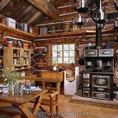 Log cabin kitchen, love the stove!