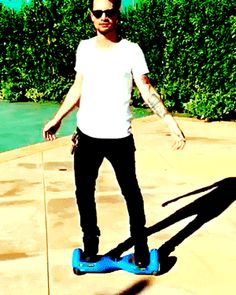 Yes, look at me, peasants. I am Brendon Urie on a hoverboard thing // Peace, Love, and Bands