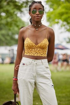 Name: Arielle Desmornes Age:17 Where are you from? New York. What do you do? Art student. Who are you here to see? Kanye, Jamie XX. How would you describe your festival look? Sunflower :) What's your best festival memory ever? Death Grips @ Afro Punk. @sunglasshut #ad