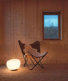 Simple wood walls have been used throughout this Norwegian cabin to tie in with the nature outside.