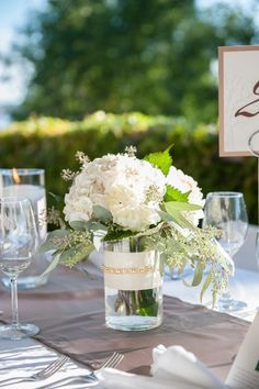 Simple white flower arrangement for pre-ceremony or reception table.