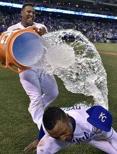 Kansas City Royals' Jarrod Dyson (1) dodges the first bucket of water from Salvador Perez (13) after the teams 3-1 win over the Pittsburgh Pirates during Tuesday's baseball game on July 21, 2015 at Kauffman Stadium in Kansas City, Mo. Dyson hit a two run double in the eighth to break a 0-0 tie.