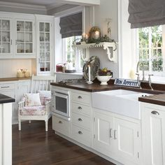 Love the richer color hardwood floors to contrast with existing cabinets.  Replace plantation shutters with fabric to soften space.  Carrera marble.