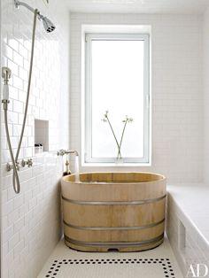 A Japanese hinoki-wood soaking tub anchors Midler's bath.