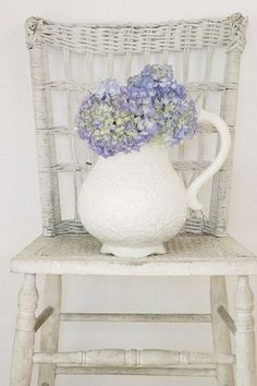 ,Hydrangeas in ironstone pitcher on wicker chair - what's not to love?
