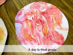 Making Planets with shaving cream and food coloring!
