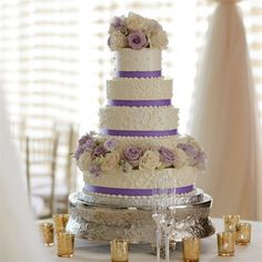 Purple bands and fresh roses turned this white cake into an eye-catching display.  Idea cam from theknot.com/weddings