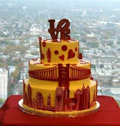 Philadelphia Skyline and Love Sculpture Wedding Cake with Yellow and Red Icing.
