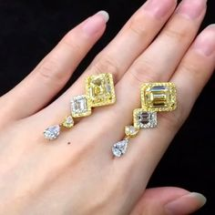A unique pair of 5 carats each, Fancy Yellow Emerald Cut dangling diamond earrings. Fit for a princess.