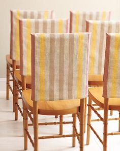 Fabric Slipcovers:  Turn a tote sans strap upside down for instant chair decor. Choose this pink-and-yellow scheme for a tropical or desert locale, or opt for a deeper hue for a winter wedding.