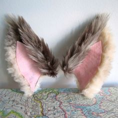 Faux fur wolf ears (could be used for other animals as well).  Includes an armature & structure of sorts.