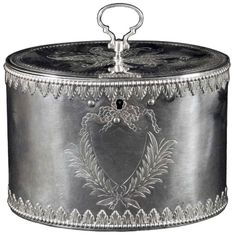 A good Georgian tea caddy of oval form the engraved lid surmounted by a loop handle. The body decorated with bead and leaf chased border and leaf and ribbon engraving around the vacant cartouche. Signed/Inscribed/Dated: Sheffield 1775 by Richard Morton & Co.