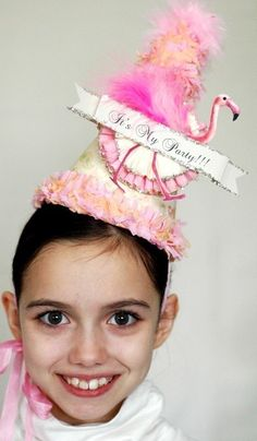 If this feathery frilly festive topper doesnt say ITS ALL ABOUT ME... then nothing will.   This hat is an explosion of hot pink feathers and orange
