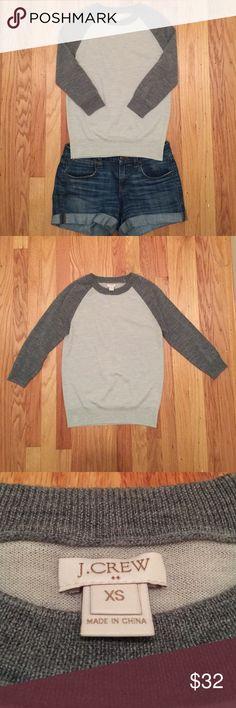 J. Crew 3/4 Sleeve Baseball Style Sweater Cute 3/4 sleeve raglan sleeve grey sweater from J.Crew. 100% merino wool. Never worn. Comes from a smoke free home. J. Crew Sweaters Crew & Scoop Necks