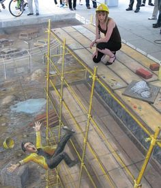 """Slight Accident on a Building "" by Julian Beever.  An English, Belgium-based chalk artist who has been creating trompe-l'œil chalk drawings on pavement surfaces since the mid-1990s."