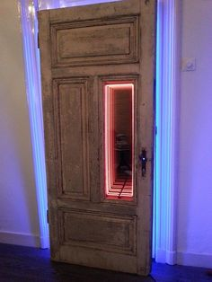 Portals....old french door with lots of patina, blue backlight and a tunnel vision mirror with a thin 6mm red neon tube.