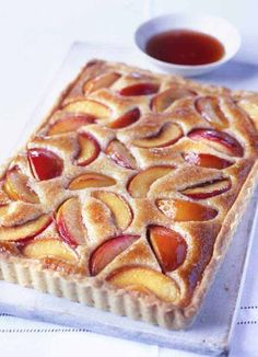 hours · Vegetarian · This peach and almond tart is a little effort to make, but the results are delicious, with a light hazelnut and almond frangipane holding the poached peach slices. You can skip the pastry making part… Just Desserts, Delicious Desserts, Dessert Recipes, Yummy Food, Oreo Desserts, Lemon Desserts, Fudge Recipes, Sweet Pie, Sweet Tarts