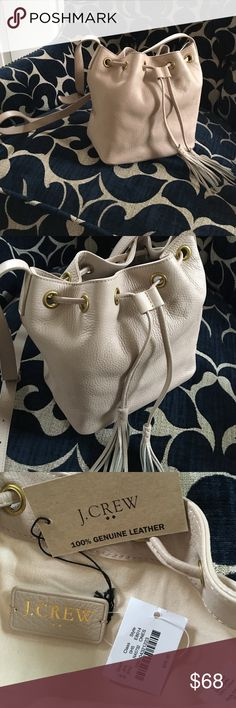 """J.CREW TAN COLOR LEATHER BUCKET BAG WITH TASSELS 100% genuine leather. 8 1/4""""H x 11 1/4"""" W x 4 1/2""""D. 21"""" handle drop. Drawstring closure. J. Crew Bags Crossbody Bags"""