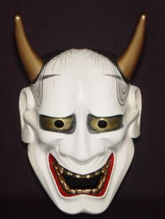 般若 (Hannya) The Hannya mask is a mask used in Japanese theater to represent a jealous female demon or serpent. It possesses two sharp bull-like horns, metallic eyes, and a leering mouth split from ear to ear. It is used in Noh, Kyogen, and even Shinto ritual Kagura dances.