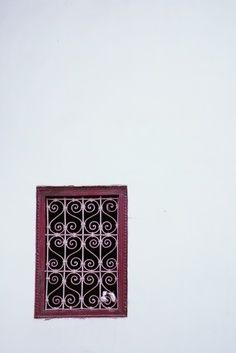 Wrought iron window grille with decorative heart motifs