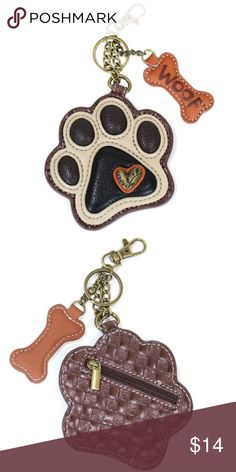 """NWT Ivory Paw Print Key Fob Conveniently small, fun, and functional! Hold your keys with style!  Paw Print Ivory with detailed stitching Squishy pads like a pup's!  Brass toned heart Faux leather bone with """"Woof""""  Zippered pocket - holds coins, flash drives, and more! Textured faux leather trim Features antique brass toned hardware Patterned fabric lining  Materials: Synthetic leather Color: Ivory/Black/Brown Dimensions: 4"""" x 0.25"""" x 5"""" Chala Accessories Key & Card Holders"""