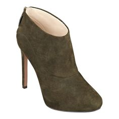 """As seen in the October issue of People StyleWatch. Simply elegant. That's the only way to describe our Navajoe high heel booties. Navajoe features a foot flattering almond toe design and back zip for easy on/off. Leather or suede upper; simply mouse over your color choice for upper information. Man-made sole. Imported. 1/2"""" hidden platform. 4 1/2"""" high heels."""