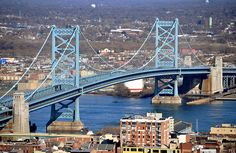 The Ben Franklin Bridge, Philadelphia PA.  1) Because it's a suspension bridge, and they rock.  2) Because it's an awesome shade of blue.  3) Because it feels like home.