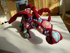 Ravelry: krtek93's Zafira the Dragon.  When I clicked on the photo the larger made all the detail show up.