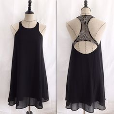 Black dress Length is approx 26.5 inches. Pit to pit is approx 15 inches.  Black razor back dress with mesh detailing with silver embroidered flowers. There isn't a size tag on the dress but it can possibly fit a small or medium. Brand is lucca couture Urban Outfitters Dresses