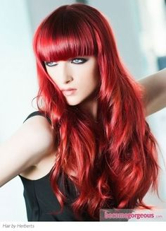 Best Hairstyles for Red Hair: Puffy Waves with Blunt Bangs