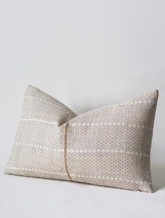 Linen cushions and pillows for home decor, featuring textile design by Susan Connor