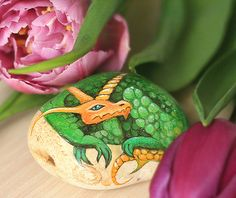 Stone with a hand-painted horned dragon talisman by SkadiaArt