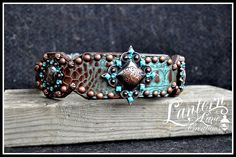 Custom dog collar for a Belgian Malinois, copper/turquoise hide and conchos