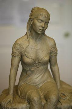 Closeup of woman sculpture.