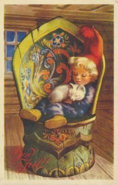 Gutt med katt sitter i rosemalt stol -