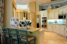Love the pale cabinets and floor in this kitchen, along with the breakfast counter.    House of Turquoise: Merry Christmas!!