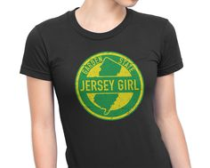 "Jersey Girls rule the world. Stylish tee with the words ""Jersey Girl"" resembling a distressed Garden State Parkway sign."