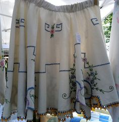 Embroidered tablecloth upcycled into a skirt