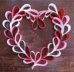 I think this is cute.  I don't know what we'd do with them once they are made...But I just like this.  Paper heart wreath  K.S.