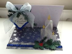 Handmade Christmas easel card using snow effect acetate, illusion card and cutting dies