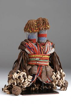 Africa | Doll from the Dowayo people from northern Cameroon | Wood, glass beads, cowrie shells and leather