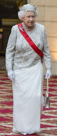 The Queen wears a Susanna clutch, costing £580, for astate banquet at the Elysee Palace, Paris, hosted by President Francois Hollande of France as part of the Queen's State visit to France in 2014