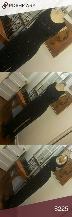 Shine Bright!!! Amazing beaded gown in excellent condition. 100% beaded silk shell. 100% polyester lining. Hooks & zips in back. padded bra cups in bust. front side slit. sz L B 36in W 30in H 40in L 60in Scala Dresses
