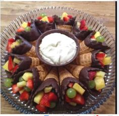 Fill waffle cones dipped in chocolate with assorted fruits and berries then dip in your favorite fruit dip.