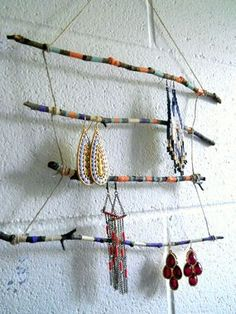 Use a few good twigs, paint, and twine to make this boho-inspired Twig Jewelry Display. http://thestir.cafemom.com/home_garden/188688/17_genius_gorgeous_diy_jewelry