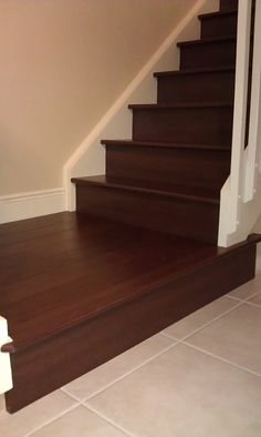 This is a hardwood from Naturally Aged Flooring called Walnut Cognac that we installed on this landing and staircase in Lake Worth at the West residence. Hardwood Stairs, Basement Inspiration, Lake Worth, Palm Beach Gardens, Palm Beach County, Sunrooms, Carpet Tiles, Landing, Flooring